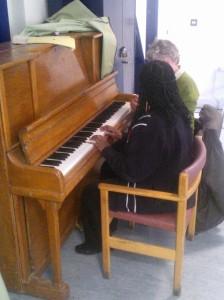 A CTC piano lesson in progress.