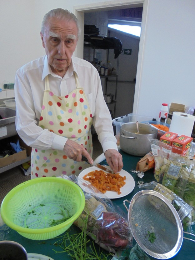 Paul in the kitchen chopping dried apricots for the Moroccan couscous